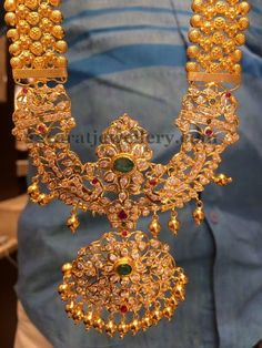 Jewellery Designs: Gold Haram with Pathakam Locket