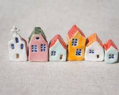 set of 5 ceramic houses in a row  painted with acrylic colors