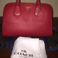 NWT Small RED COACH satchel  I love this purse because it's small and the color red is such a deep true red it's gorgeous!. We all know that Coach makes a high-quality bag so not much more to to describe. The color and size is the key to the beauty of this bag, plus the leather is high quality as it is soft without being broken in first. Perfect for those days where you don't need a bunch of things with you like out with your friends! What can I say this bag can sell itself! Coach Bags Mini…
