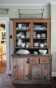 See top piece with angled ends. Something like this for open cabinet where non-mirrored medicine cabinet is.~~~~ Ilove the all white dishes in the brown woodend cabinet~~~~ Kitchen Hutch, Kitchen Storage, Kitchen Decor, Rustic Kitchen, Country Kitchen, Kitchen Trolley, Garage Storage, Kitchen Ideas, Kitchen Unit