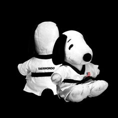 """This adorable 17 inch cuddly PUPPY PLUSH is wearing a white Taekwondo uniform decorated with U.S.A. flag patch on chest and embroidered """"TAEKWONDO"""" on the back. Uniform may beremoved. A perfect gift for any boy or girl who loves Taekwondo."""