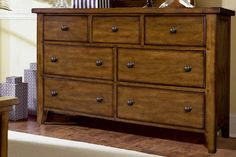 Master Bedroom: Jordan's Furniture - Aspenhome Cross Country Traditional Dresser with Seven Storage Drawers