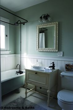 sewing table as vanity. claw foot tub. hex tile floor. wainscoating.