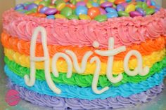 Rainbow 1st birthday cake by The Manchester Cakehouse