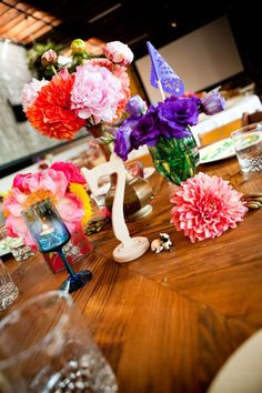 Stunning Wedding Centerpiece Ideas with Chic Purple Hue. To see more: http://www.modwedding.com/2013/12/15/purple-wedding-centerpiece-ideas/