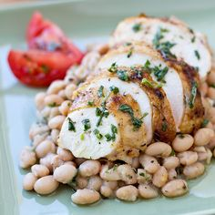 Classic roasted chicken over creamy Italian white beans. The ideal Sunday supper.
