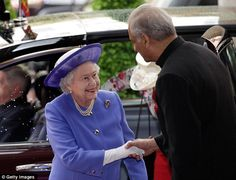 Warm welcome: The Queen is greeted by the Commonwealth Secretary-General, Kamalesh Sharma