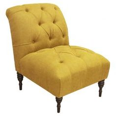 """Diamond-tufted accent chair with a pine wood frame and foam cushioning. Handmade in the USA.  Product: ChairConstruction Material: Solid pine wood, polyurethane and polyester fillColor: French yellowFeatures: Handmade in the USADimensions: 34.5"""" H x 33"""" W x 24.5"""" DNote: Assembly requiredCleaning and Care: Spot clean only"""