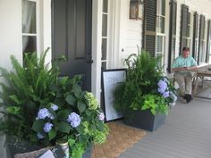 southern living idea house - pic from Gracious Southern Living....ferns and sweet potato vine in front porch planters