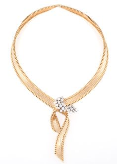 Cartier Diamond 18 karat Gold and Platinum Ribbon Necklace  A French, Mid-Century, 18 karat gold and platinum necklace with diamonds by Cartier. The necklace has 33 round-cut diamonds with an approximate total weight of 2.85 carats. In a ribbon tied bow motif. Original box. 1960s