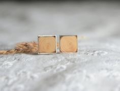 These square wooden earrings are made from a natural wood and sterling silver. I used a fallen tree branch from pine tree. It could be a great gift for a nature and forest lover.  Wearing them you can always have a piece of nature with you :)  *** Wood dimensions: ~ 9 mm (0,35)  *** You will receive these earrings carefully wrapped in lovely wooden jewelry box, brown paper and tied with linen cord. They are ready to send. *** All my crafts are handmade from scratch with care. Each peace is…
