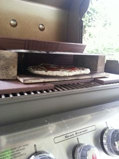 Built a pizza oven inside my Weber Genesis gas grill using material I already owned. The bottom consists of unglazed ceramic tiles with an old pizza stone on top to diffuse the heat. The top is a pizza steel held up by two bricks.  The steel serves as a great battery to hold heat in when you open the lid as well as cook the top of the pizza. Might lower it for my next trial.  The back has three more tiles at an angle to harness the rising heat from the back of the grill and roll it over the…