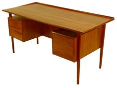 Danish Modern Teak Desk by Peter & Nielson Lovig for Dansk  I saw one of these in Lincoln NE... very cool