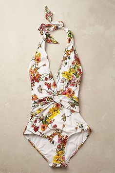 Floral Plunge Swimsuit. The floral one piece is pretty and flattering for a summer get away.