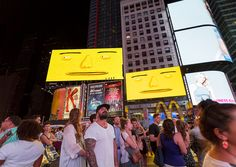 os-gemeos-times-square-midnight-moment-parallel-connection-designboom-52