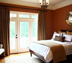 Burnt orange walls, dark wood furniture, white, brown, and gold accents