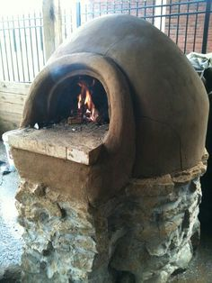 Cute stone oven for breads and pizza.