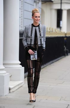 Chanel girl: Poppy Delevingne steps out in London wearing a tweed jacket with a limited ed...