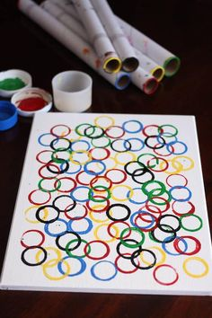 Easy Olympic Craft for Kids - kids can stamp up a piece of Olympic Ring Art to hang in the playroom or the classroom in honour of the Summer or Winter Olympic games - Happy Hooligans olympic games Olympic Ring Art for Preschoolers Olympic Games For Kids, Winter Olympic Games, Kids Olympics, Summer Olympics, Special Olympics, Happy Hooligans, Summer Art Projects, Projects For Kids, Olympic Crafts