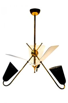 Jean Boris Lacroix (1902-1984) ceiling light; 3-arm ceiling light brass and steel with black and white enameled perforated sheet metal. France 1950's.