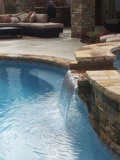 Stacked stone spa with stone spillway into pool. Hearthstone Environments. home@HsEnviro.com, www.HsEnviro.com
