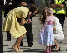 This moment was so cute! When getting off of the jet in Canada, Kate Middleton was greeted by the sweetest, little cancer patient. It was so precious!!