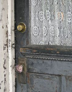 Vintage door with lace curtain