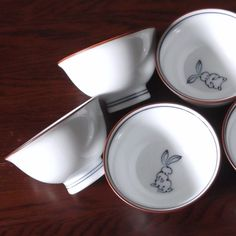 Japanese Pottery Arita Ware 5 teacups with rabbits  http://www.akarijapanart.com/product/arita-ware-teacups-with-five-rabbits/