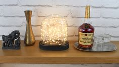 The Galaxy Dome makes a beautiful, decorative table lamp. It's perfect for additional or mood lighting. Glass Bell Jar, The Bell Jar, Glass Vessel, Glass Domes, Starry String Lights, Unique Table Lamps, Visual Display, Mason Jar Lamp, Light Table