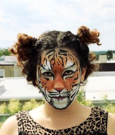 makeup / face / painting / realistic / tiger / leopard / print / spots / orange / white / brown / curly / hair / curls / roof / rooftop
