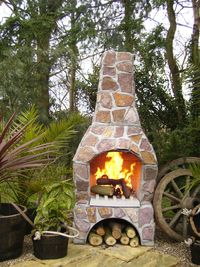 Outdoor fireplace made of stone with storage underneath for wood Outdoor Rooms, Outdoor Living, Outdoor Decor, Outdoor Kitchens, Stone Bbq, Cottage Porch, Four A Pizza, Small Fountains, Outside Living