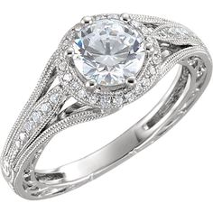 This beautiful Engagement ring combines the elegance of a vintage setting with a modern halo. Pave set diamonds along the shank and on the halo. The center stone is not included and can be chosen from