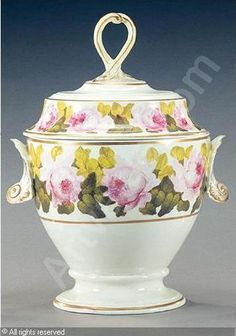 A derby urn shaped ice pail and cover: porcelain painted with bands of full-blown pink roses with green foliage, shell-moulded handles. 19th c.