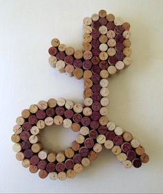 This is a one-of-a-kind piece of wine cork art made-to-order with assorted corks. Letter-shaped art piece of letter of your choice in cursive, print or other font made of assorted wine-colored corks and an cork-colored outline. The wood backing is hand-cut for each piece and hanging brackets are attached so they are ready to hang. Intended as an art piece, but can be used as a functional cork board, This letter W measures at the tallest and widest points at app. 12 tall by 12 wide and app…