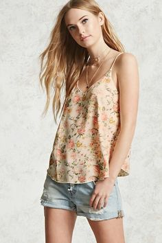 A woven cami featuring a V-neck, cami straps, a floral print, and a boxy silhouette.