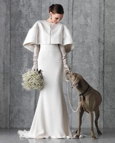 The on-hue pup certainly makes a nice aisle partner, but we're talking about the cool color combo shown here. She's wearing a winter-white neoprene capelet over a strapless column dress with sleek gray leather gloves. And baby's breath goes from filler to fabulous when massed in a romantic bunch and tied with a ribbon the color of a South Sea pearl.Vera Wang silk-crepe gown and gloves; Tadashi Shoji capelet, 702-733-6071; Tamsen Z earrings