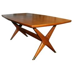"""from Modern Living Supplies via first Dibs. Fredrik Kayser for Gustav Bahus Captain\'s Teak Dining Table  Norway  1960\'s  Frederik Kayser for Gustav Bahus captains teak extension dining table.Solid and impressive teak trestle base construction with X motif legs connected with center stretcher detailed with brass sabots.Boat shape top complete with 3 extension boards all freshly restored.Leaves measure at 13.75\"""" each making the total length when 3 leaves are in use at 116.25\"""", ea"""