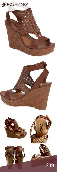 "Lucky Brand Urban Laffertie Woven Wedge Sandals Gorgeous boho chic t-strap sandal cast from richly textured leather and lofted by a woven wedge and platform. 4"" heel; 1 1/4"" platform (size 8.5). Adjustable strap with buckle closure. Leather upper/synthetic lining/rubber sole. Brand new in box! Lucky Brand Shoes Sandals"