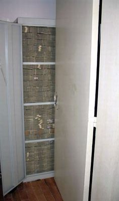 Mexican Drug Lord home after being raided Another cabinet stack tight with cash - all