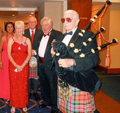 Master Piper opened the Thistle Ball at Bird Key Yacht Club observing the10th Anniversary of the twinnng of Sarasota and Dunfermline, Scotland.  Caledonian Club of West Floirida President Phyliss McIlraith and Sister Cities Association President Tom Halbert welcome the salute.  The Caledonian Club of West Florida has been an alliance member of Sister Cities Association of Sarasota since 2002