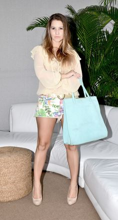 flower shorts and blue bag
