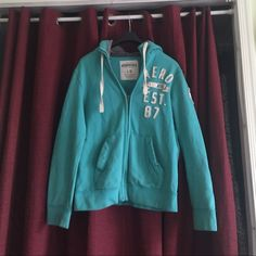 Aeropostale teal hooded never worn This is a great deal never worn teal hoodie large not much to say if u know Aeropostale great deal Aeropostale Tops
