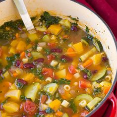 Autumn Minestrone Soup Recipe Soups with carrots, yellow onion, olive oil, garlic, vegetable broth, yukon gold potatoes, butternut squash, medium zucchini, diced tomatoes, fresh rosemary, fresh thyme, bay leaves, ground black pepper, salt, ditalini pasta, kale, white kidney beans, shredded parmesan cheese