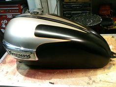 My friends Triumph gas tank ready to paint in the workshop. tape - Matt Black rattle can paint. Triumph T120, Triumph Bonneville, Triumph Motorcycles, Motorcycle Paint Jobs, Motorcycle Tank, Paint Bike, Cafe Racing, Art Of Man, Pinstriping