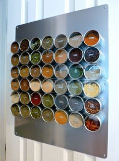 Put spice tins on refrigerator with magnets. Glue the magnets on the tins, instructions here.