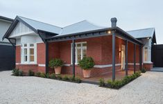 Unbricked House by Merrylees Architecture in Brighton, Melbourne Red Brick Exteriors, Red Brick Homes, House Exteriors, Modern Entry, Exterior Makeover, Front Rooms, House Paint Exterior, Facade House, House Facades