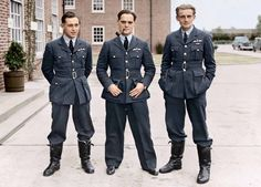 Squadron Leader Douglas Bader, commanding No. 242 (Canadian) Squadron, with Pilot Officer William Lidstone 'Willie' McKnight and Acting Fl.Lt. George Eric Ball outside the Officers Mess building, Duxford, Cambridgeshire. October 1940.
