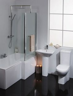 Like the shoeet stule and floor color   - guest bath maybe?Give a plain white bathroom suite a contemporary twist with a black laquer floor. Monochrome at its most effective. Image by Better Bathrooms