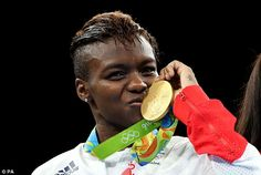 The 33-year-old kisses her gold medal after her superb performance in the ring…