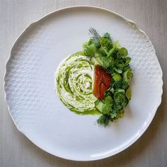 Smoked mackerel, fresh cucumber and juice, parsley and chive oil, buttermilk, peas powder and fresh herbs salad.